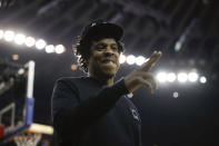Jay-Z gestures while walking to his seat during the first half of Game 3 of basketball's NBA Finals between the Golden State Warriors and the Toronto Raptors in Oakland, Calif., Wednesday, June 5, 2019. (AP Photo/Ben Margot)