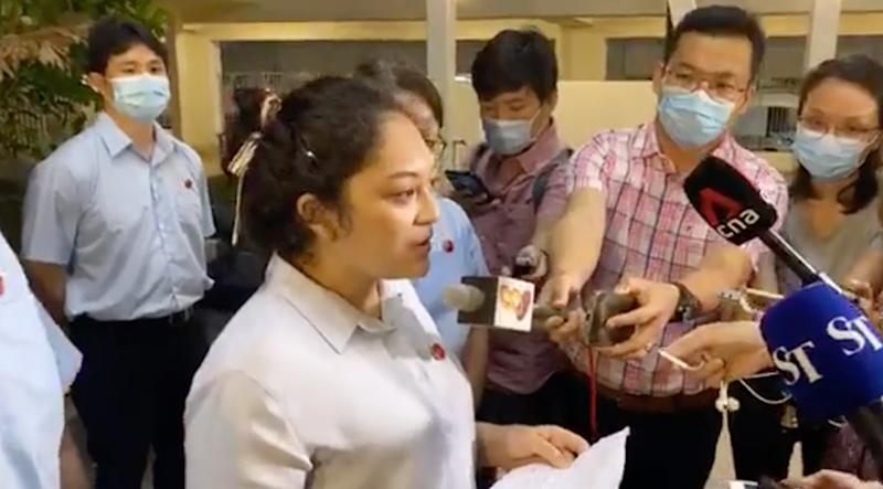 Workers' Party Raeesah Khan speaking to reporters at Compassvale Link on the night of 5 July 2020. (SCREENCAP: Yahoo News Singapore)