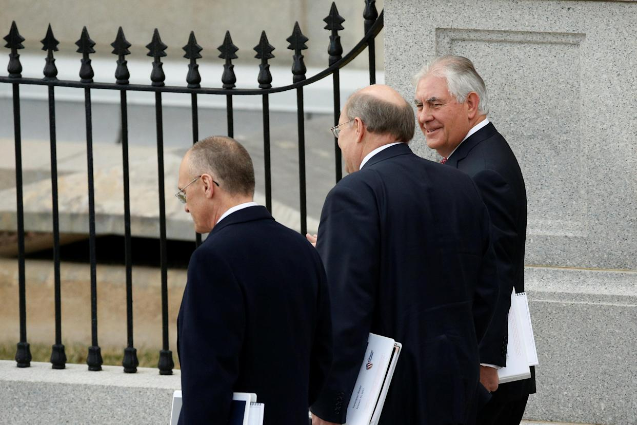 Labor Secretary nominee CKE Restaurants CEO Andy Puzder (L) walks with former Exxon Mobile CEO and Secretary of State nominee Rex Tillerson (R) and Deputy Chief of Staff Joe Hagin.