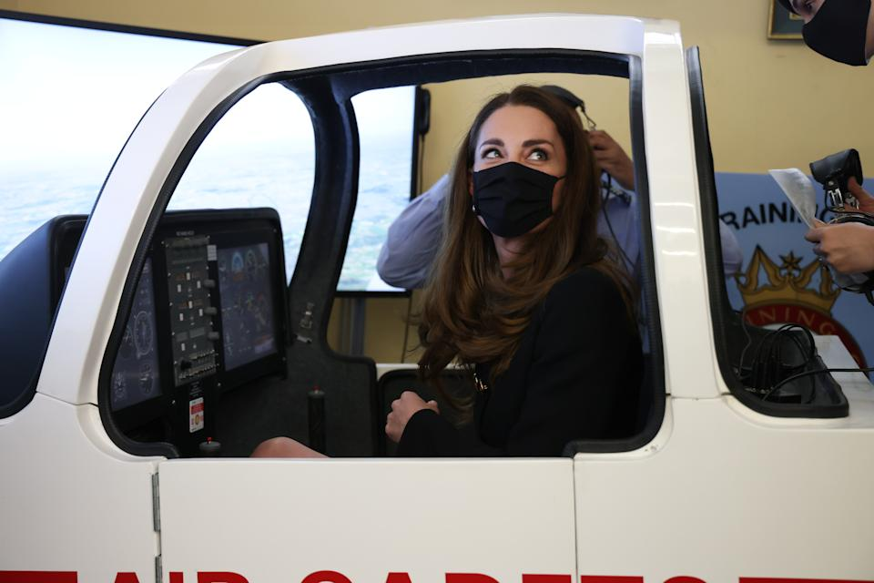 The Duchess of Cambridge sits in a flight simulator during a visit to 282 (East Ham) Squadron, RAF Air Cadets, Cornwell VC Cadet Centre, in east London. Picture date: Wednesday April 21, 2021.