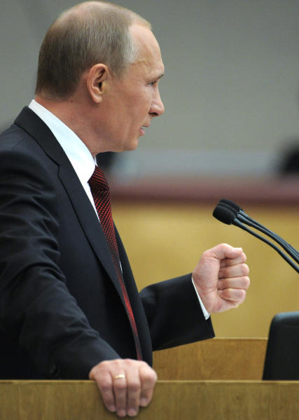 Russian Prime Minister and President-elect Vladimir Putin addresses the State Duma, the Russian Parliament's lower house, in Moscow, Russia, Wednesday, April 11, 2012. Putin on Thursday pledged to improve the country's dismal investment climate, calling it crucial for the country's development. (AP Photo/RIA Novosti, Alexei Druzhinin, Government Press Service)
