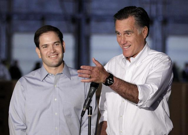 FILE - In htis April 23, 2012, file photo Republican presidential candidate, former Massachusetts Gov. Mitt Romney, campaigning with Sen. Marco Rubio, R-Fla., talks to reporters in Aston, Pa. When Republican presidential candidate Mitt Romney picks his running mate, odds are he'll select someone with far less wealth than his own. Unless he chooses Hewlett-Packard CEO Meg Whitman, one of the richest women in America. Some of the potential Republican vice presidential nominees are grappling with the same financial issues as many of their countrymen. (AP Photo/Jae C. Hong, File)