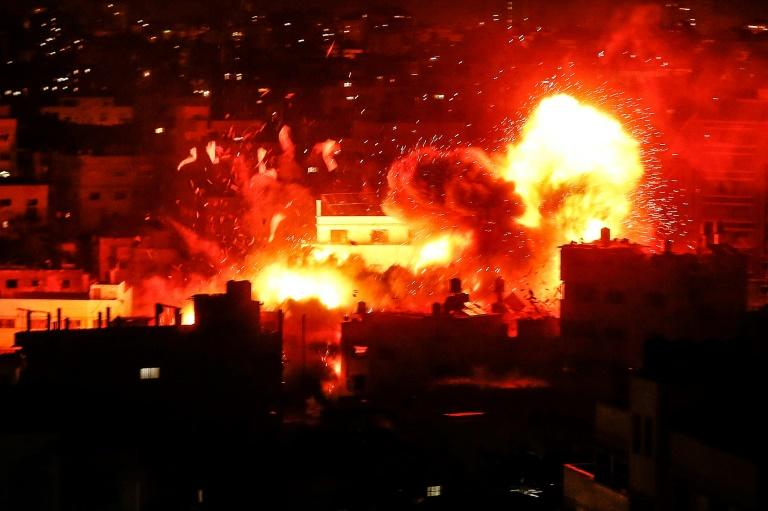 A fireball rises over the Hamas-run Al-Aqsa television building in Gaza City after an Israeli air strike on November 12, 2018 as a deadly flare-up of violence threatens a new war