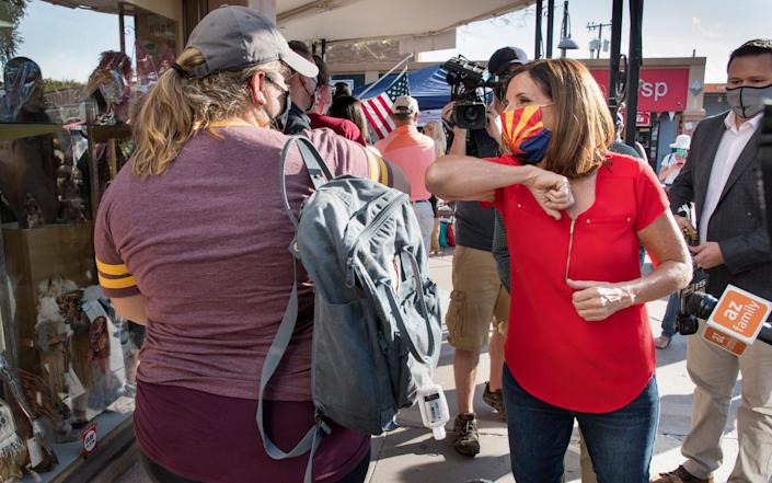 Martha McSally, right, is in a fight to keep her Senate seat in Arizona - EPA
