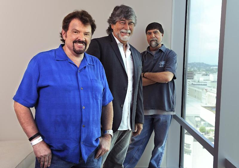 "In this Tuesday, Aug. 13, 2013 photo, Jeff Cook, Randy Owen and Teddy Gentry from the American country music band Alabama pose for a portrait in Nashville, Tenn. Alabama has launched a tour and released a new album this week, ""Alabama & Friends,"" that features duets of the group's biggest hits with top country stars. (Photo by Donn Jones/Invision/AP)"