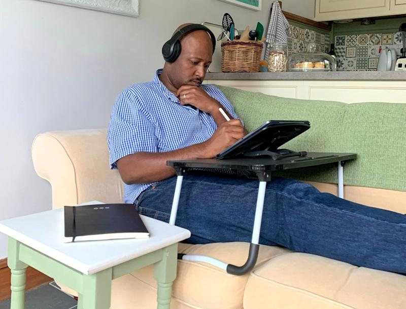 Christian working from their Airbnb. (Photo: Christian Azolan )
