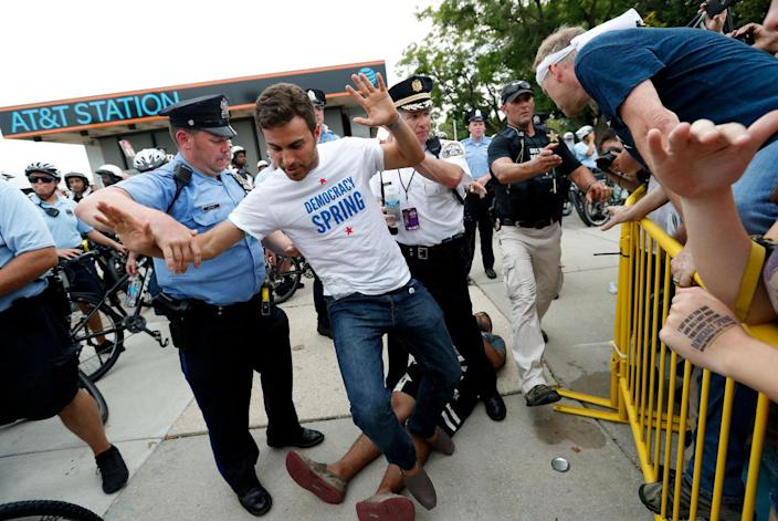 <p>Demonstrators are taken into custody by police after climbing over a fence near the AT&T Station, Monday, July 25, 2016, in Philadelphia, during the first day of the Democratic National Convention. (Photo: Alex Brandon/AP)</p>