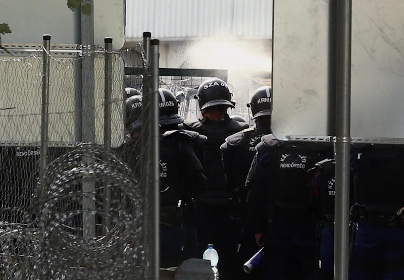 Hungarian riot use tear gas as migrants attempt to break out from the no-man's land between the two countries at the Hungarian-Serbian border, September 16, 2015 in Roszke