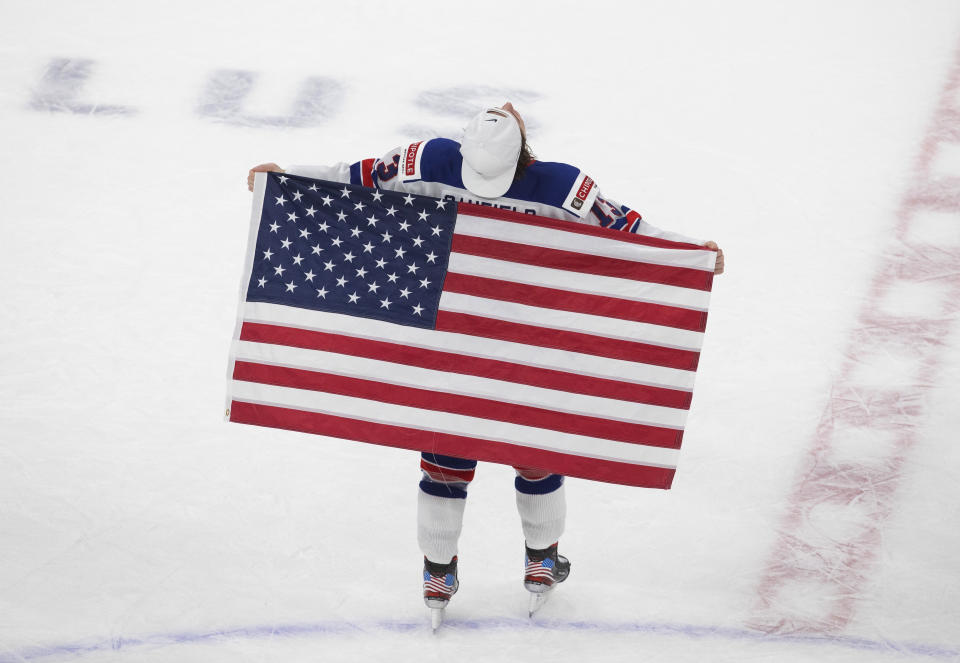 United States' Cole Caufield celebrates the team's win over Canada in the title game in the IIHF World Junior Hockey Championship, Tuesday, Jan. 5, 2021, in Edmonton, Alberta. (Jason Franson/The Canadian Press via AP)