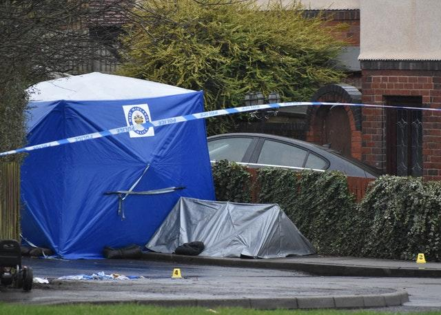 A police forensic tent in Wilson Road, near Pensnett Road, after two men were killed in the early hours of Thursday