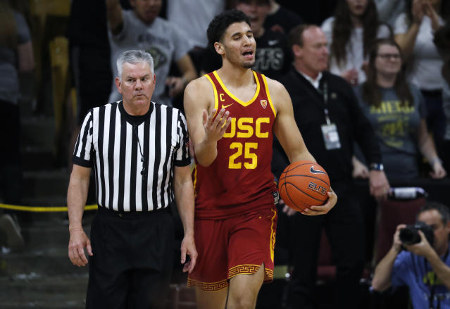 USC forward Bennie Boatwright, right, argues with the referee after Boatwright was called for a foul in the second half of an NCAA college basketball game against Colorado Saturday, March 9, 2019, in Boulder, Colo. Colorado won 78-67. (AP Photo/David Zalubowski)