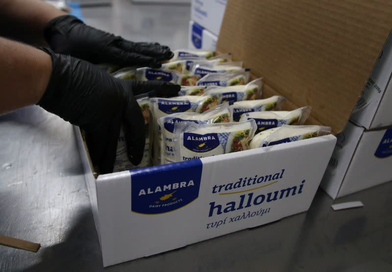 A worker packs halloumi cheese at the Petrou Bros Dairy in Aradippou,