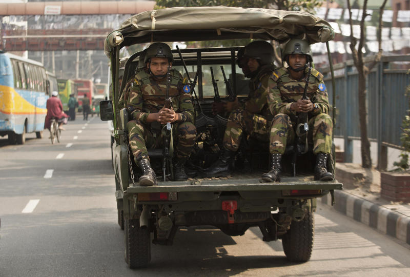 Bangladeshi army soldiers sit inside a vehicle as they patrol the streets on the eve of the general elections in Dhaka, Bangladesh, Saturday, Dec. 29, 2018. Bangladesh Prime Minister Sheikh Hasina is poised to win a record fourth term in Sunday's elections, drumming up support by promising a development bonanza as her critics question if the South Asian nation's tremendous economic success has come at the expense of its already fragile democracy. (AP Photo/Anupam Nath)