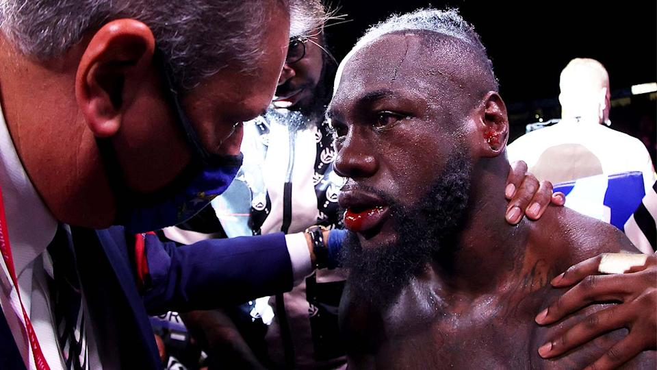Deontay Wilder (pictured) sitting in his corner after losing to Tyson Fury.