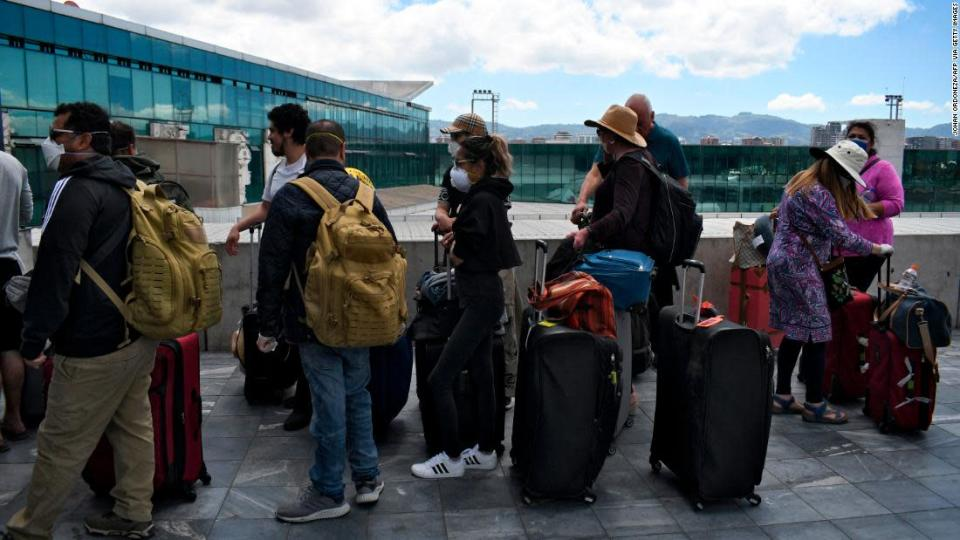 """<p>Travellers wait in line for a charter flight coordinated by the United States embassy to take them back home, at the La Aurora international airport in Guatemala City on March 23, 2020. - The United States is trying to repatriate some 13,500 Americans stranded overseas by the coronavirus pandemic but does not believe it can reach all of them, the State Department said Monday. (Photo by Johan ORDONEZ / AFP) (Photo by JOHAN ORDONEZ/AFP via Getty Images)</p><div class=""""cnn--image__credit""""><em><small>Credit: Johan Ordoneza/AFP via Getty Images / AFP via Getty Images</small></em></div>"""