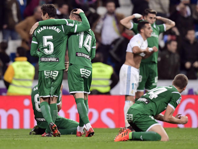 "Leganes players celebrate their remarkable victory over <a class=""link rapid-noclick-resp"" href=""/soccer/teams/real-madrid/"" data-ylk=""slk:Real Madrid"">Real Madrid</a> in the Copa Del Rey quarterfinals. (Getty)"