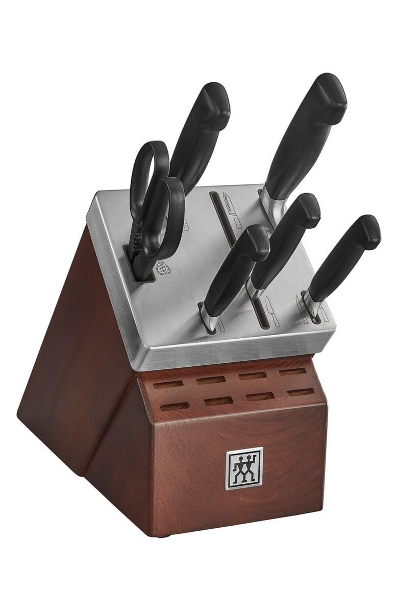<p><span>ZWILLING J.A. HENCKELS Four Star Self-Sharpening Knife Block &amp; Knife Set</span> ($200, originally $350)</p>