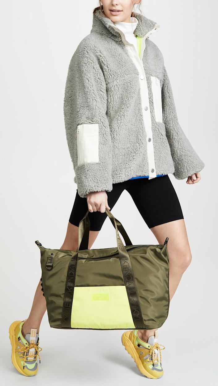 """<h3><a href=""""https://www.saksoff5th.com/kendall-kylie-colorblock-weekender-bag/product/0400010194000"""" rel=""""nofollow noopener"""" target=""""_blank"""" data-ylk=""""slk:Kendall + Kylie Weekender"""" class=""""link rapid-noclick-resp"""">Kendall + Kylie Weekender</a></h3><br>Crafted out of a durable technical-weave with a secure zip-top and optional crossbody strap, this athleisure-style tote is ready to sport up your weekend getaway games."""