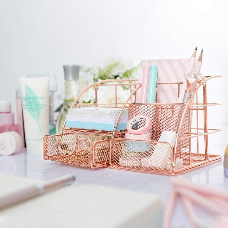 <p>This <span>Rose Gold Desk Organizer</span> ($33) is ideal for storing pens, pencils, tape, paper clips, and more.</p>