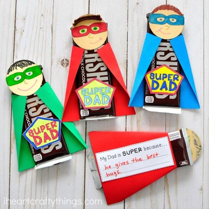 """<p>Turn an ordinary candy bar into the perfect gift to show Dad just how """"super"""" you think he is. </p><p><em>Get the tutorial at <a href=""""https://iheartcraftythings.com/super-dad-fathers-day-gift.html"""" rel=""""nofollow noopener"""" target=""""_blank"""" data-ylk=""""slk:I Heart Crafty Things."""" class=""""link rapid-noclick-resp"""">I Heart Crafty Things.</a></em></p>"""