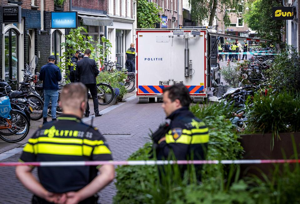 Police at the site of a shooting in Amsterdam, the Netherlands, 6 July 2021, where a man was seriously injured. (EPA)