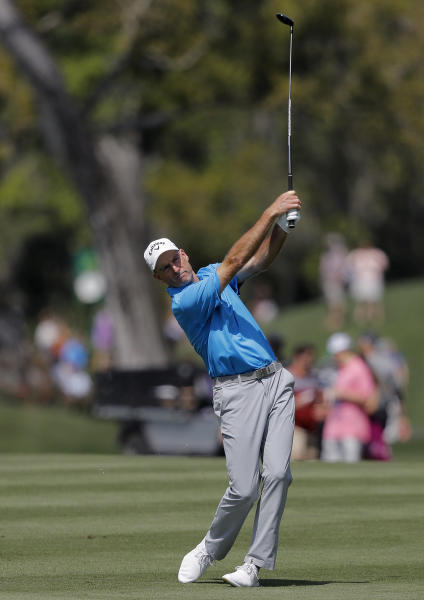 Jim Furyk hits his second shot off the 16th fairway during the second round of The Players Championship golf tournament Friday, March 15, 2019, in Ponte Vedra Beach, Fla. (AP Photo/Gerald Herbert)