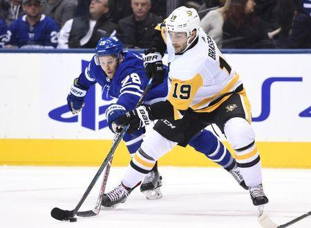 FILE PHOTO - Oct 18, 2018; Toronto, Ontario, CAN; Toronto Maple Leafs forward Connor Brown (28) attempts to poke the puck away from Pittsburgh Penguins forward Derick Brassard (19) in the third period at Scotiabank Arena. Mandatory Credit: Dan Hamilton-USA TODAY Sports