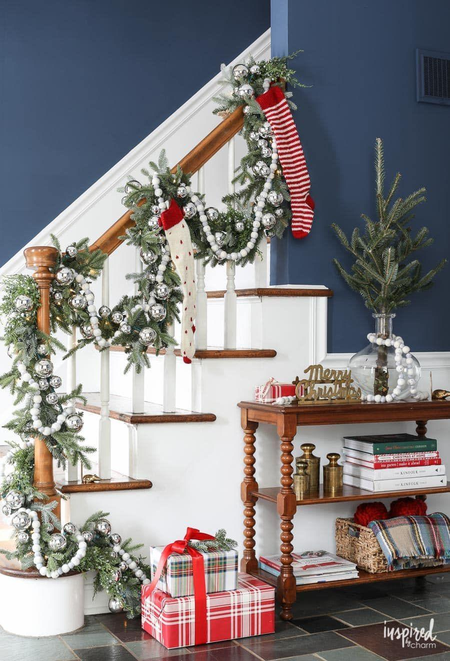 """<p>Shiny white and silver ornaments and bright red accents, like stockings, really pop against evergreen garland and dark walls. </p><p><em>See more at <a href=""""https://inspiredbycharm.com/how-i-plan-my-christmas-home-decor/"""" rel=""""nofollow noopener"""" target=""""_blank"""" data-ylk=""""slk:Inspired By Charm"""" class=""""link rapid-noclick-resp"""">Inspired By Charm</a>.</em></p><p><a class=""""link rapid-noclick-resp"""" href=""""https://www.amazon.com/Clever-Creations-Shatterproof-Christmas-Decorations/dp/B01IU62LCK?tag=syn-yahoo-20&ascsubtag=%5Bartid%7C10072.g.34479907%5Bsrc%7Cyahoo-us"""" rel=""""nofollow noopener"""" target=""""_blank"""" data-ylk=""""slk:SHOP ORNAMENTS"""">SHOP ORNAMENTS</a></p>"""