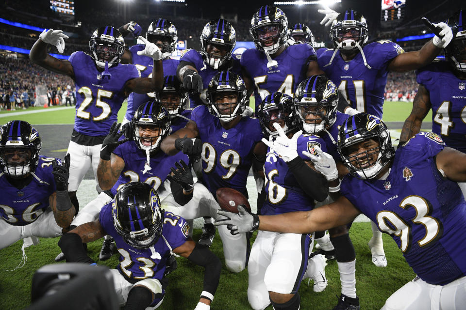 Baltimore Ravens linebacker Odafe Oweh (99) celebrates with teammates after recovering a Kansas City Chiefs fumble in the second half of an NFL football game, Sunday, Sept. 19, 2021, in Baltimore. Baltimore won 36-35. (AP Photo/Nick Wass)