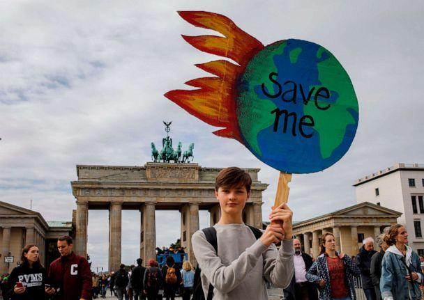 PHOTO: A protester holds a globe-shaped sign reading 'Save Me' during the 'Fridays for Future' demonstration in Berlin during a protest for climate action on September 20, 2019, part of a global climate action day. (David Gannon/AFP/Getty Images)