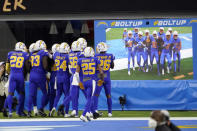 The Los Angeles Chargers celebrate after an interception by Jahleel Addae during the second half of an NFL football game against the Atlanta Falcons Sunday, Dec. 13, 2020, in Inglewood, Calif. (AP Photo/Ashley Landis)