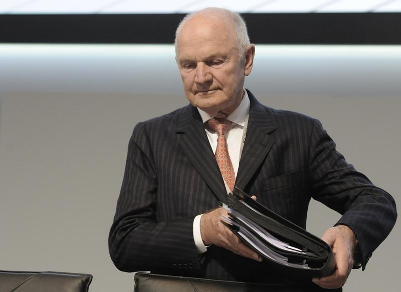 Piech, chairman of the board of German carmaker Volkswagen, carries his documents as he arrives at the 51th annual shareholders meeting in Hamburg.