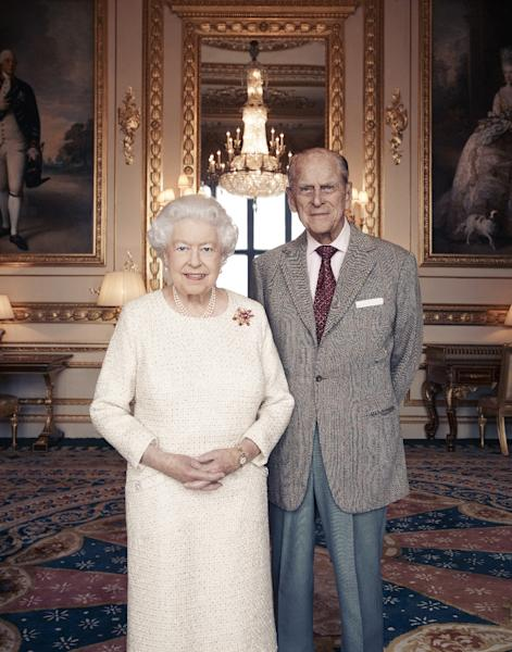 In this photograph released by Buckingham Palace, taken by Camera Press photographer Matt Holyoak this month, Britain's Queen Elizabeth II and her husband, Britain's Prince Philip, Duke of Edinburgh pose in the White Drawing Room at Windsor Castle, to mark their 70th Wedding Anniversary. (AFP Photo/Matt Holyoak)