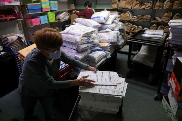 PHOTO: The election official Pam Hainault works in the ballot room organizing unused ballots returned from voting precincts after Election Day at the Kenosha Municipal Building in Kenosha, Wisconsin, Nov. 4, 2020. (Daniel Acker/Reuters, FILE)
