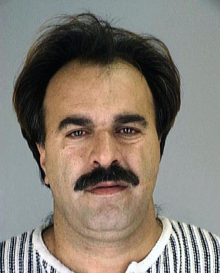 This 1996 image provided by the Nueces County Sheriff's Office shows Manssor Arbabsiar. The Obama administration on Tuesday, Oct. 11, 2011 accused agents of the Iranian government of being involved in a plan to assassinate the Saudi ambassador to the United States. Secretary of State Hillary Rodham Clinton said the thwarted plot would further isolate Tehran. (AP Photo/Nueces County Sheriff's Office)