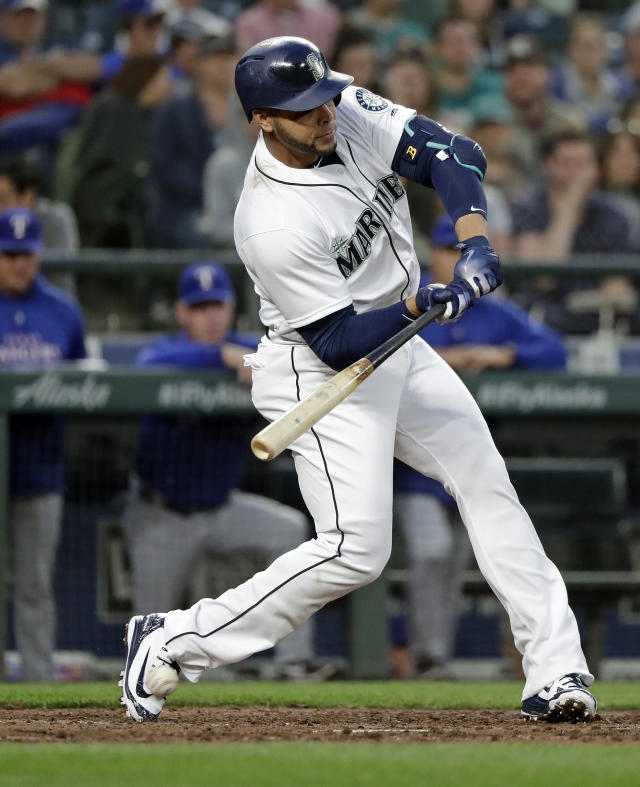 Seattle Mariners' Nelson Cruz is hit by a pitch on his right foot during the fourth inning of the team's baseball game against the Texas Rangers on Tuesday, May 15, 2018, in Seattle. Cruz was assisted off the field and left the game. (AP Photo/Elaine Thompson)