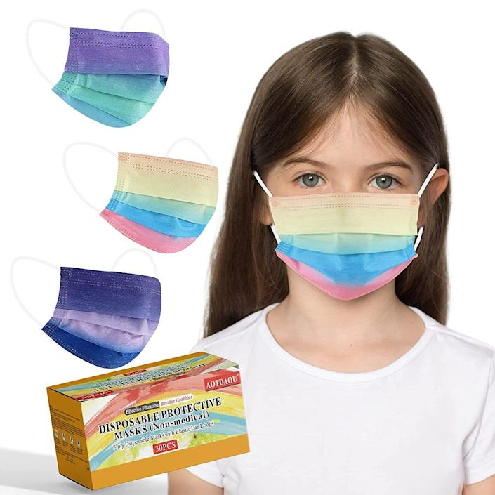 """<p><strong>AOTDAOU</strong></p><p>Amazon</p><p><strong>$15.99</strong></p><p><a href=""""https://www.amazon.com/Disposable-Pattern-Children-Breathable-Covering/dp/B0922H5RF7/ref=sr_1_115?dchild=1&keywords=disposable+face+mask+kids&qid=1627491437&s=industrial&sr=1-115&tag=syn-yahoo-20&ascsubtag=%5Bartid%7C2140.g.34252719%5Bsrc%7Cyahoo-us"""" rel=""""nofollow noopener"""" target=""""_blank"""" data-ylk=""""slk:Shop Now"""" class=""""link rapid-noclick-resp"""">Shop Now</a></p><p>These tie dye masks are sure to be a hit in any household! Their small size and gradient pattern makes them a great option for kids. </p><p><strong>Rave review: </strong>""""This mask is the perfect fit for my 9 year old. She loves the rainbow colors ! So it's easy to get her to wear this. It has a metal secure nose piece bendable just like the adults masks, yet these straps fit just right. It's not engulfing the chin like the adult masks do. I put them in the car so we always have a mask on hand. No more worries when we forget the cloth one at home. Breathable and comfortable."""" </p>"""