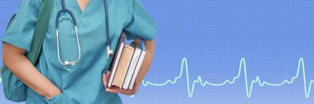 Female medical student carrying books.