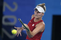 Marketa Vondrousova, of the Czech Republic, plays Elina Svitolina, of the Ukraine, during the semifinals of the tennis competition at the 2020 Summer Olympics, Thursday, July 29, 2021, in Tokyo, Japan. (AP Photo/Seth Wenig)