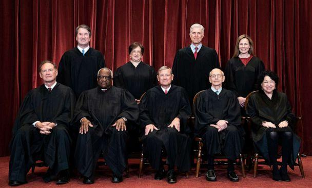 PHOTO: Members of the Supreme Court pose for a group photo at the Supreme Court in Washington, D.C., April 23, 2021. (Erin Schaff/Pool via Getty Images)