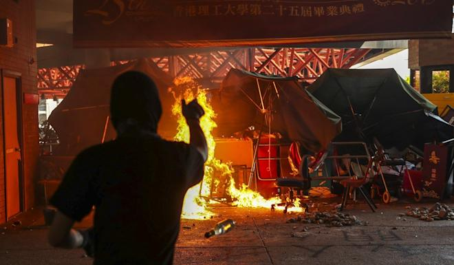Anti-government protesters set fires at Polytechnic University in Hung Hom. Photo: Sam Tsang