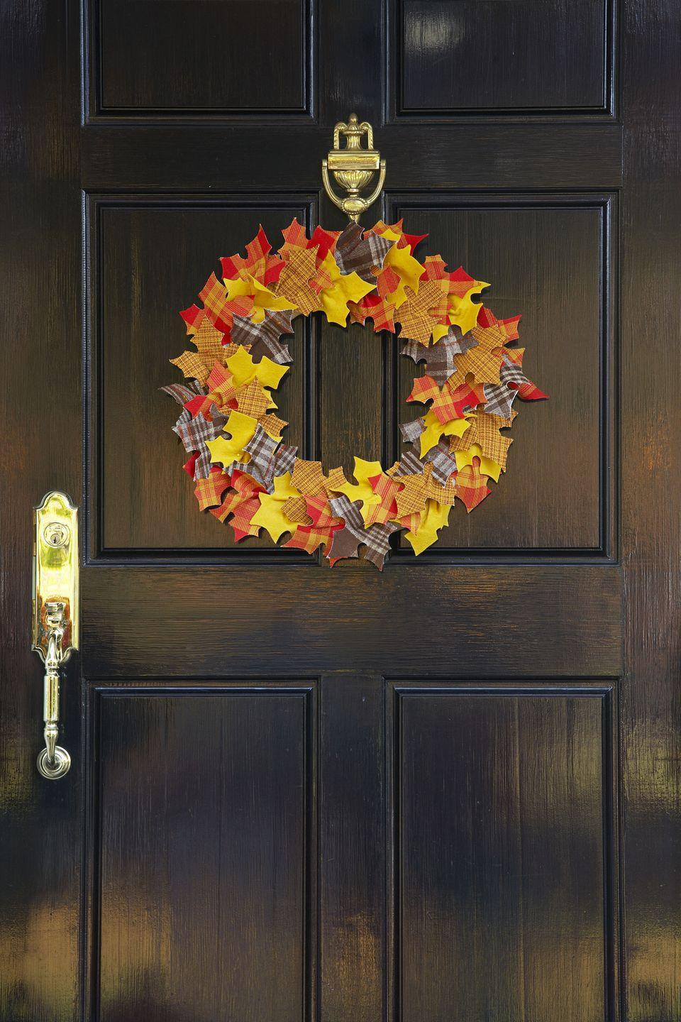 """<p>Perfect for classic decor lovers, a leaf wreath can easily add some color to a dark-colored door. </p><p><a class=""""link rapid-noclick-resp"""" href=""""https://go.redirectingat.com?id=74968X1596630&url=https%3A%2F%2Fwww.potterybarn.com%2Fproducts%2Flive-preserved-oak-leaf-wreath%2F&sref=https%3A%2F%2Fwww.goodhousekeeping.com%2Fholidays%2Fhalloween-ideas%2Fg32948621%2Fhalloween-door-decorations%2F"""" rel=""""nofollow noopener"""" target=""""_blank"""" data-ylk=""""slk:SHOP LEAF WREATH"""">SHOP LEAF WREATH</a></p>"""