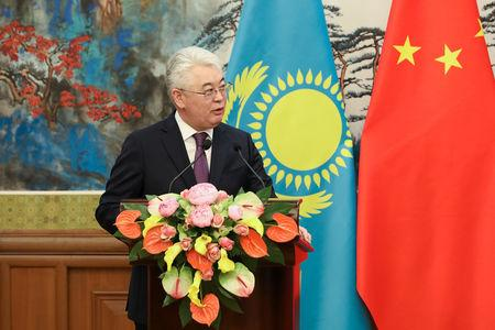 Kazakh Foreign Minister Beibut Atamkulov speaks during a news conference at the end of a meeting with Chinese Foreign Minister Wang Yi at Diaoyutai State Guesthouse in Beijing, China March 28, 2019. Andrea Verdelli/Pool via REUTERS