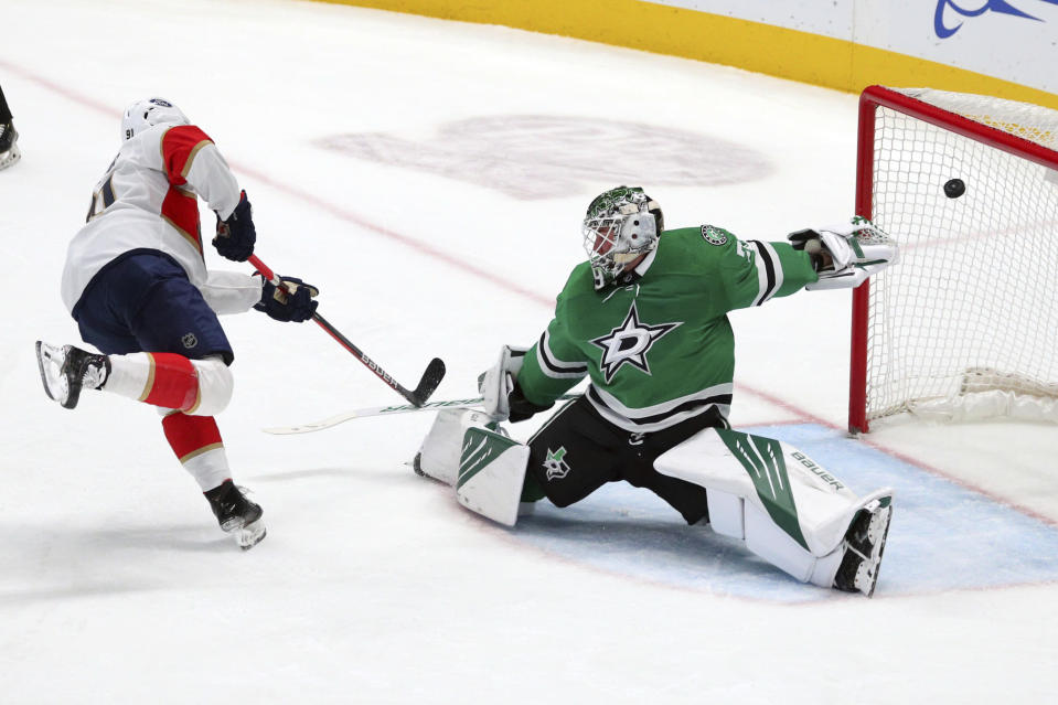 Florida Panthers left wing Anthony Duclair (91) scores against Dallas Stars goaltender Jake Oettinger (29) on a penalty shot in the first period during an NHL hockey game on Sunday, March 28, 2021, in Dallas. (AP Photo/Richard W. Rodriguez)