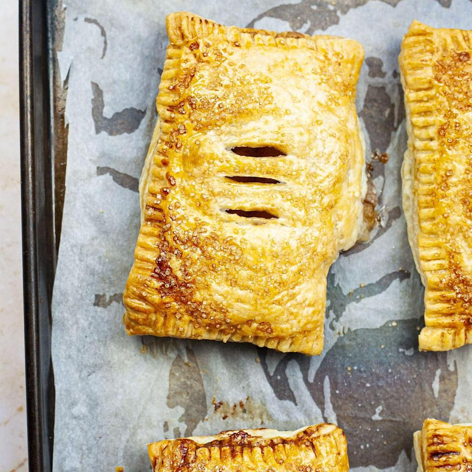 """<p>These mini apple pies are cooked with Biscoff spread so they have a wonderful spiced biscuit flavour throughout. Be careful when tucking in, as the filling gets very hot!</p><p><strong>Recipe: <a href=""""https://www.goodhousekeeping.com/uk/food/recipes/a35820018/biscoff-cinnamon-apple-puff-pockets/"""" rel=""""nofollow noopener"""" target=""""_blank"""" data-ylk=""""slk:Biscoff and Cinnamon Apple Puff Pockets"""" class=""""link rapid-noclick-resp"""">Biscoff and Cinnamon Apple Puff Pockets</a></strong></p>"""