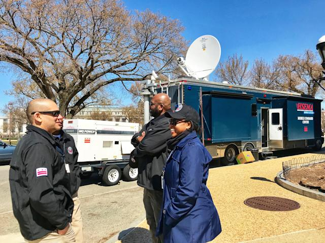 Chris Rodriguez, director of the D.C. Homeland Security and Emergency Management Agency, talks to members of his staff outside the agency's Mobile Command Unit stationed near the National Mall during the March for Our Lives in D.C. on March 24, 2018. (Photo: Caitlin Dickson/Yahoo News)