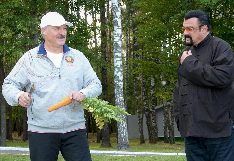 Belarus president Alexander Lukashenko peels a carrot before handing it to US action star Steven Seagal, who was visiting his country residence (AFP Photo/Stasevich Andrei Olegovich)