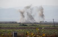 Smoke rises as targets are hit by shelling during the fighting over the breakaway region of Nagorno-Karabakh near the city of Terter