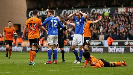 Soccer Football - Championship - Wolverhampton Wanderers vs Birmingham City - Molineux Stadium, Wolverhampton, Britain - April 15, 2018 Birmingham City's Harlee Dean is shown a red card by referee Andy Davies Action Images via Reuters/Andrew Boyers
