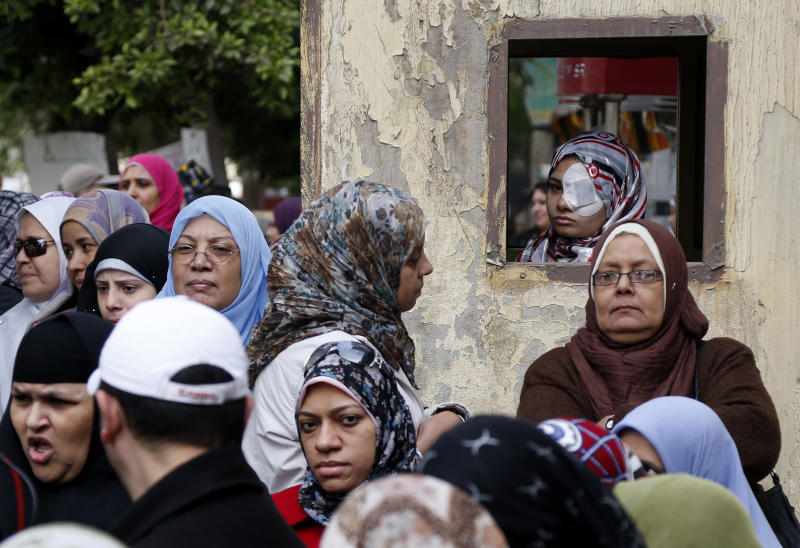 Egyptian women line up outside a polling station during a referendum on a disputed constitution drafted by Islamist supporters of President Mohammed Morsi in Cairo, Egypt, Saturday, Dec. 15, 2012. (AP Photo/Petr David Josek)